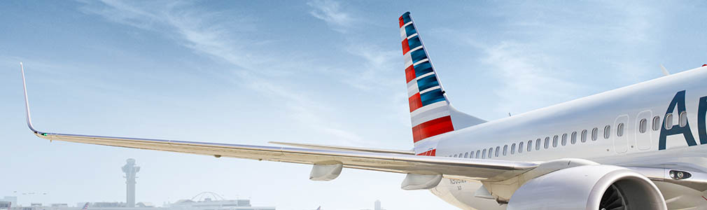 Image of customer wearing face covering waiting for plane